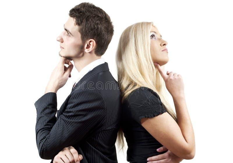 Jongen en een meisje op een grijze achtergrond royalty-vrije stock fotografie