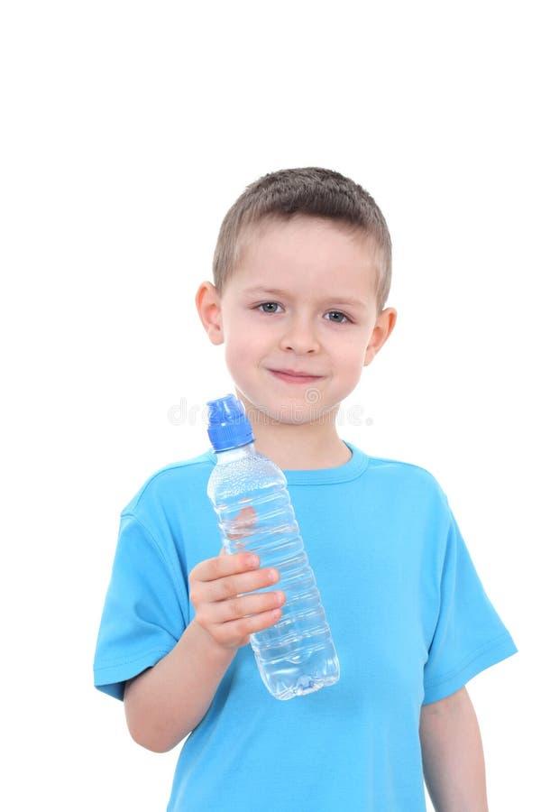 Jongen en fles water royalty-vrije stock afbeelding