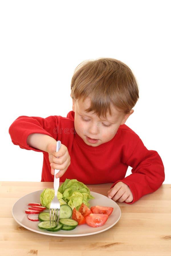 Jongen en groenten stock foto