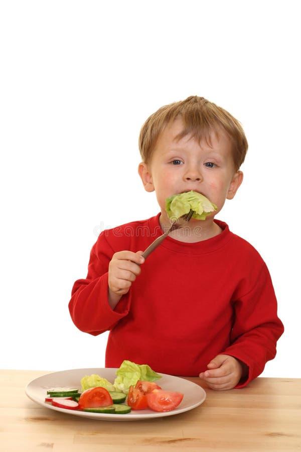 Jongen en groenten royalty-vrije stock foto's