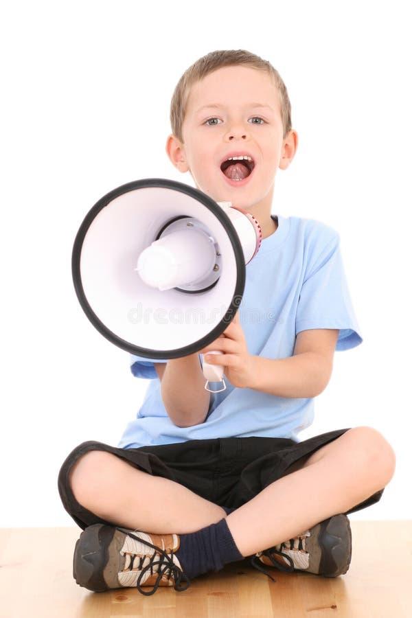Jongen en megafoon stock foto