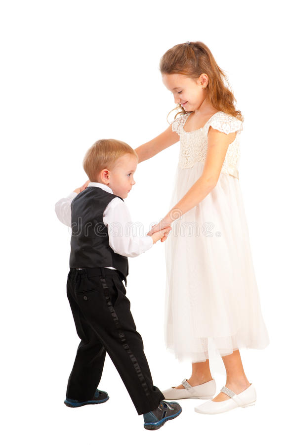 Jongen en meisje die leren te dansen stock foto