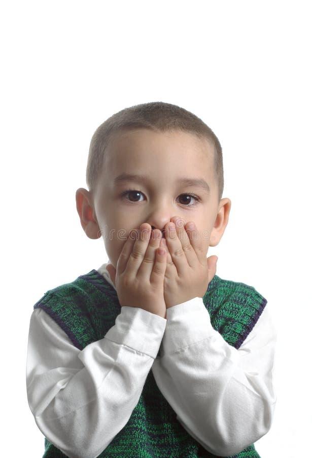 Jongen in Groene Sweater met Verraste Uitdrukking