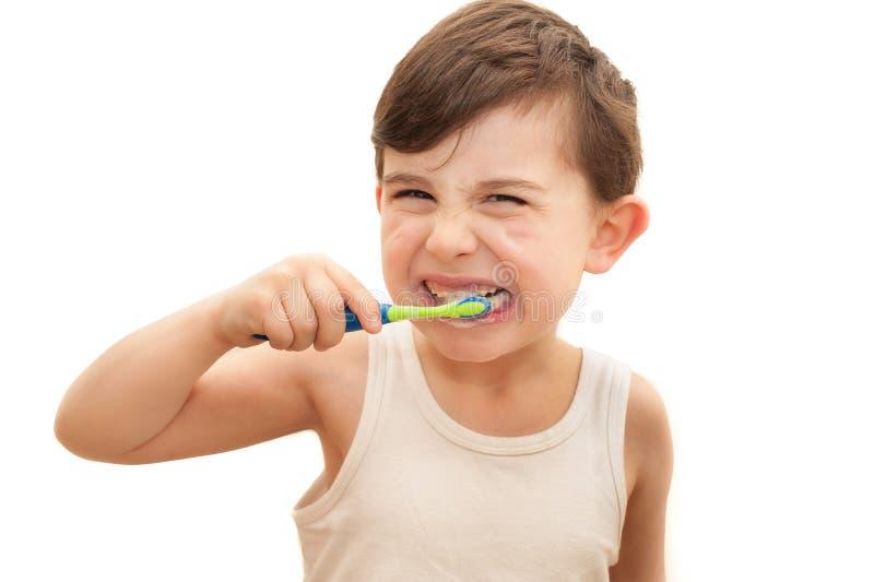 Jongen het borstelen geïsoleerde tanden stock afbeeldingen