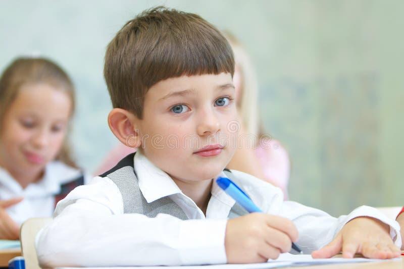 Jongen het schrijven stock afbeeldingen