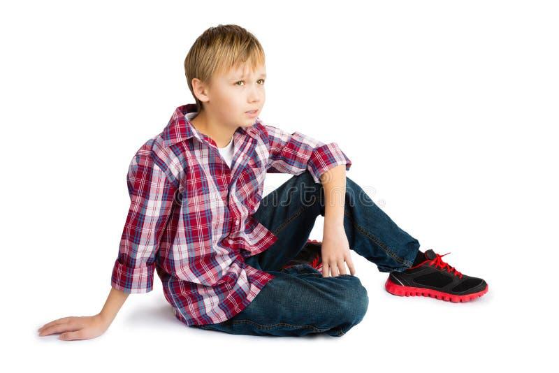 Jongen in Jeans en Geruit Overhemd royalty-vrije stock foto
