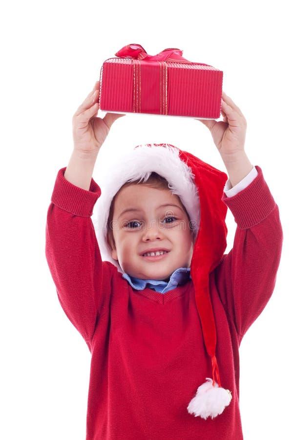 Jongen met aanwezige Kerstmis stock fotografie