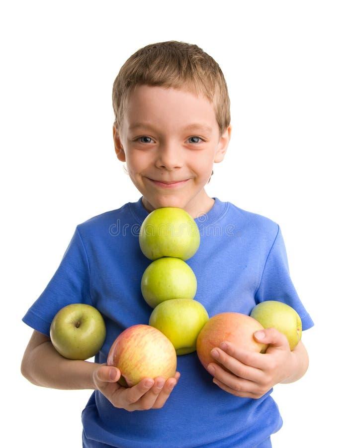 Jongen met appelen stock afbeelding