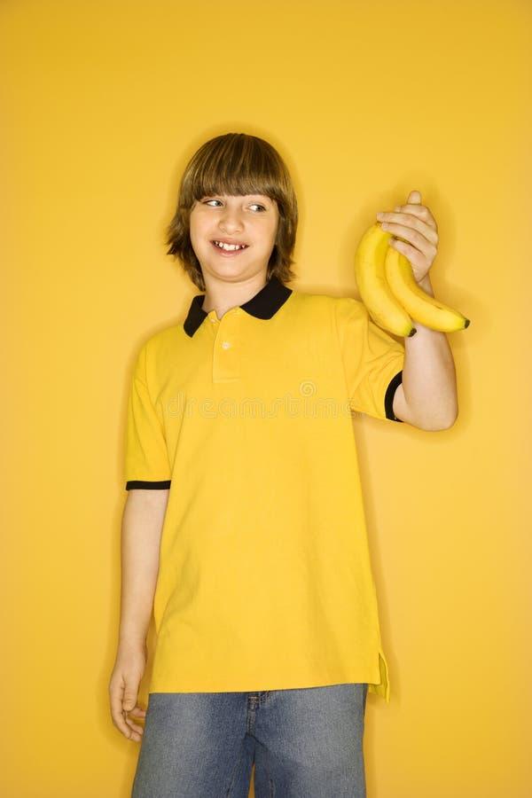 Jongen met bananen. royalty-vrije stock fotografie