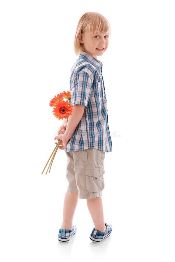 Jongen met bloem stock foto's