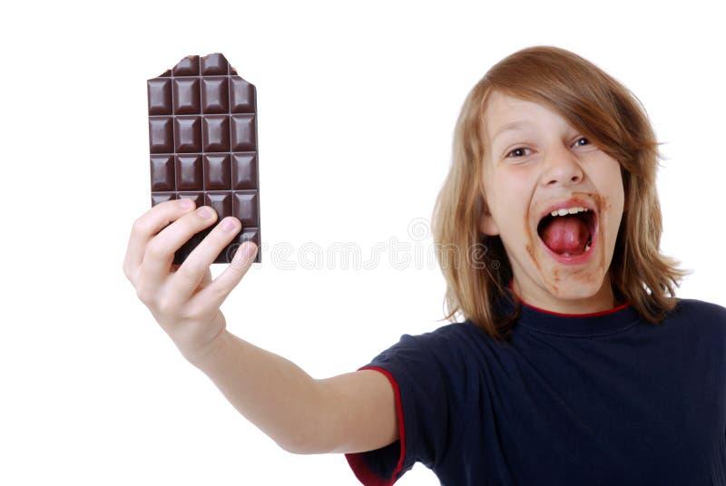 Jongen met chocolade royalty-vrije stock afbeeldingen