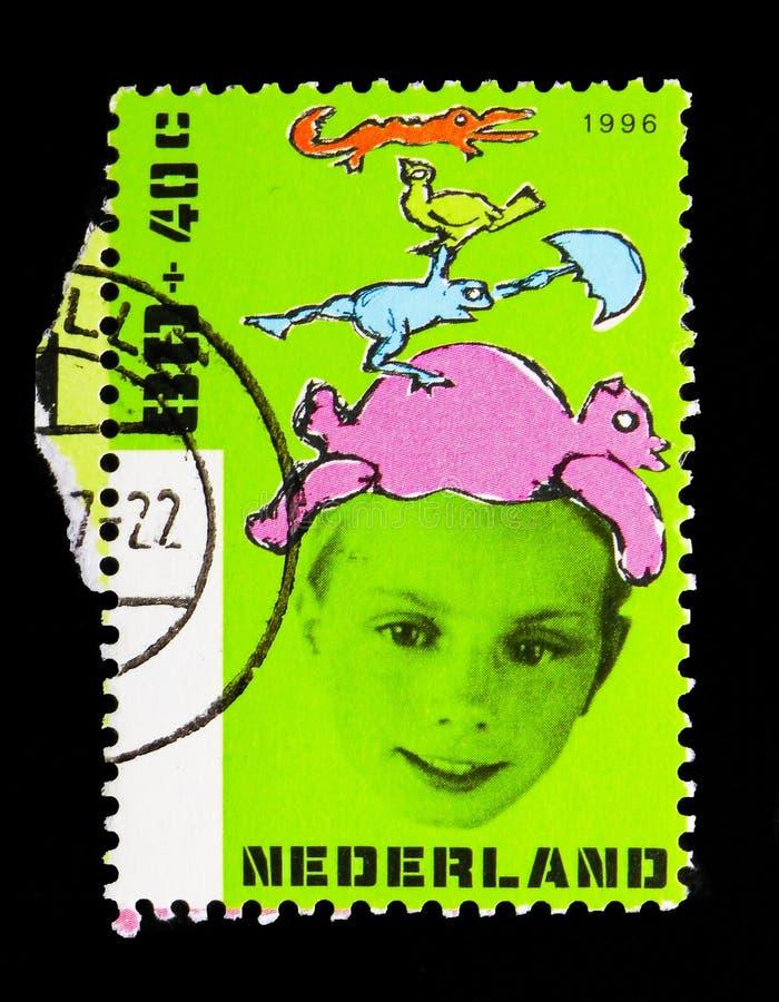 Jongen met dieren, Kinderenzegels - Jaar Gehandicapten serie, royalty-vrije stock foto's