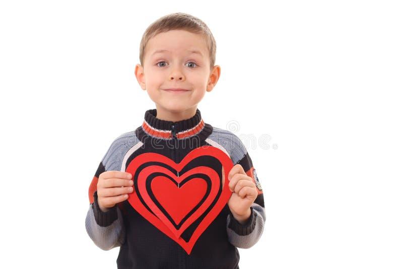 Jongen met groot hart stock foto