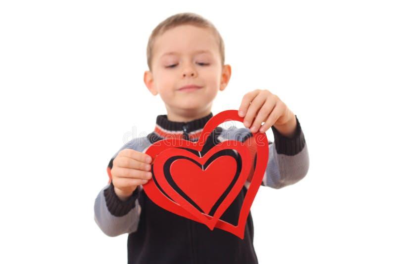 Jongen met groot hart stock afbeeldingen