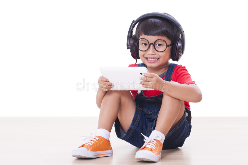 Jongen met hoofdtelefoons royalty-vrije stock afbeelding