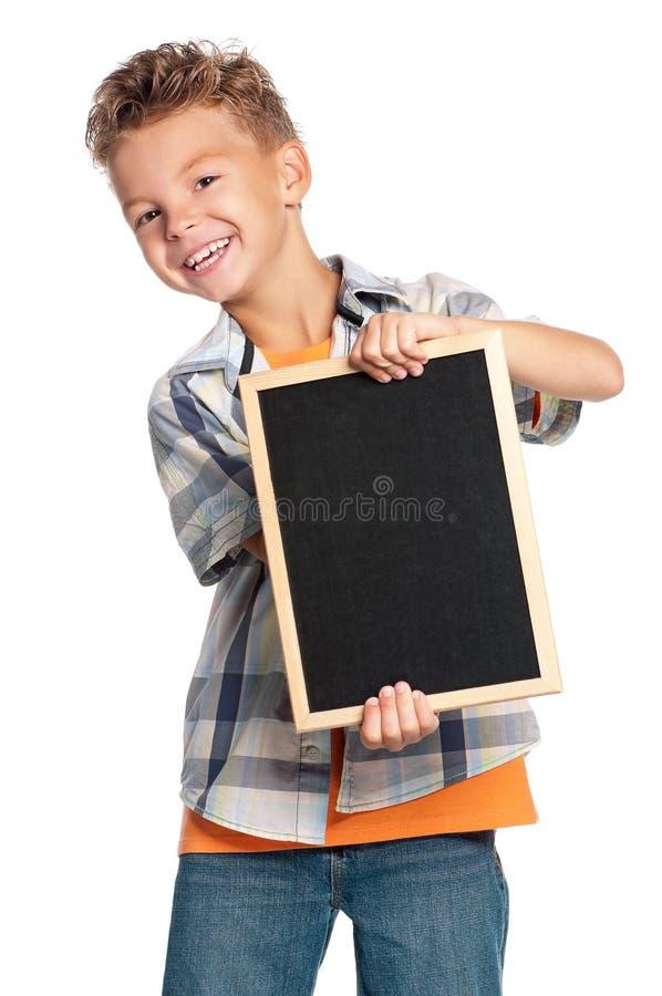 Jongen met klein bord royalty-vrije stock afbeelding