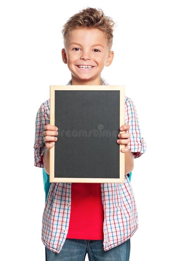 Jongen met klein bord stock fotografie