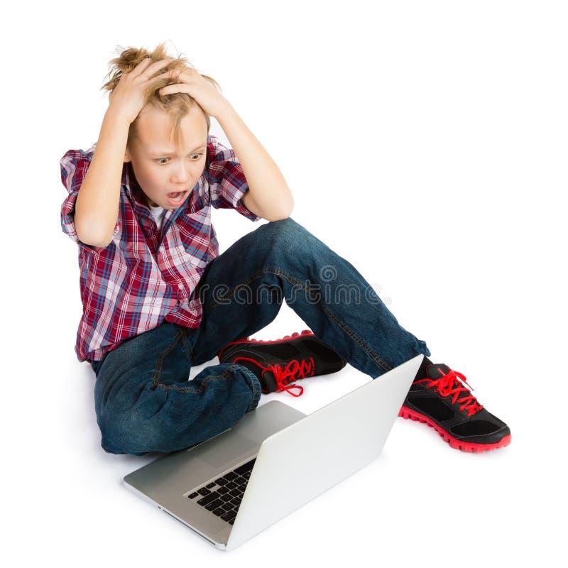 Jongen met Laptop Computer royalty-vrije stock foto's
