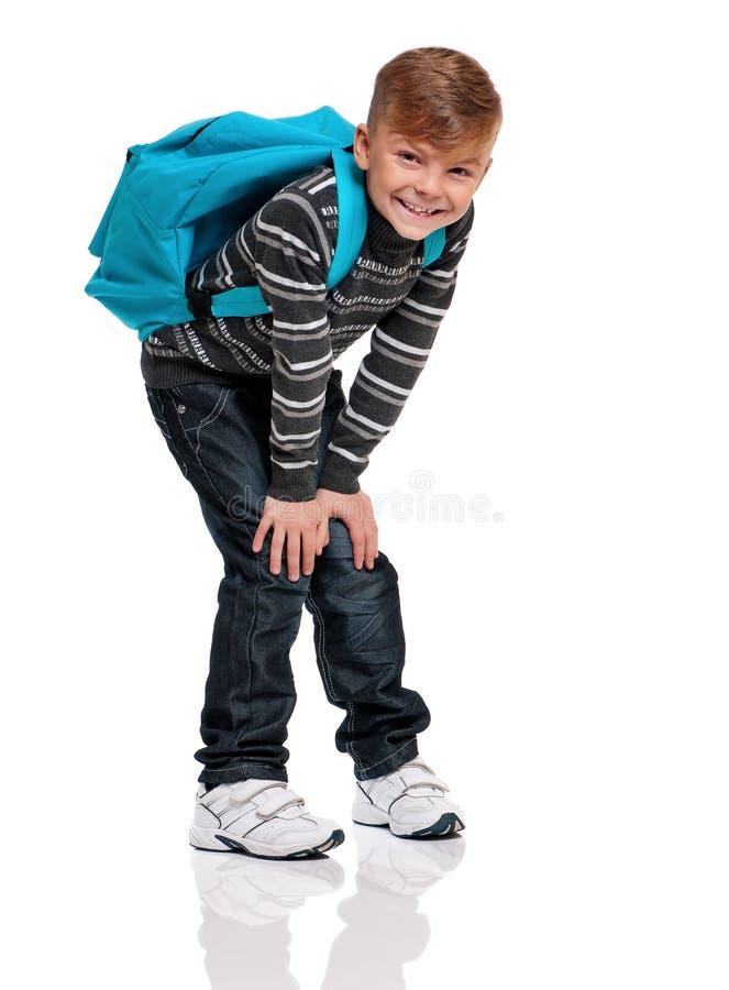 Jongen met rugzak stock afbeelding