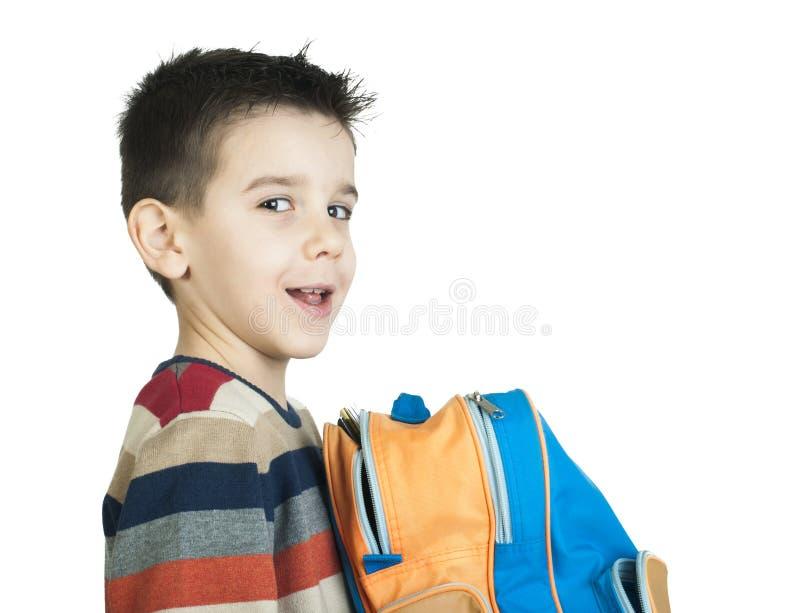 Jongen met schooltas stock foto