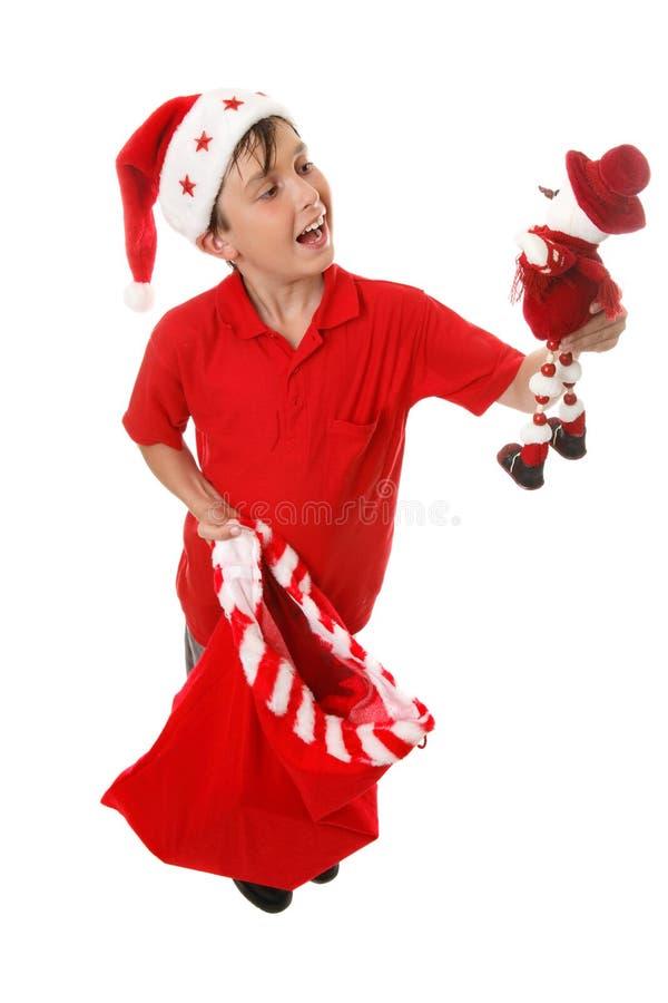 Jongen met stuk speelgoed de zak van Kerstmis stock afbeeldingen