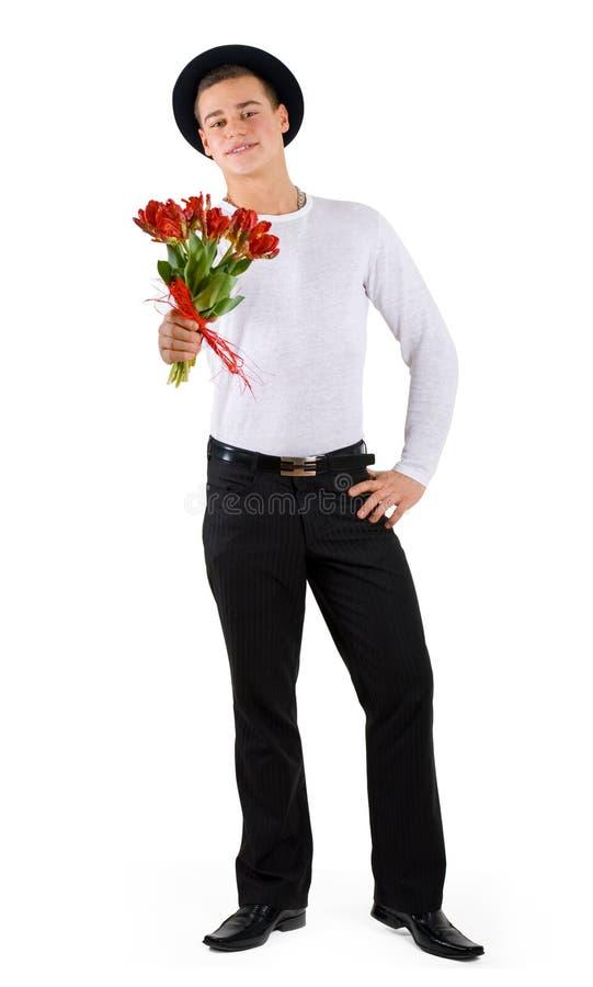 Jongen met tulpen royalty-vrije stock afbeelding