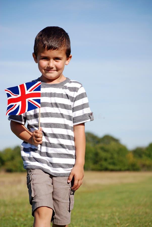 Jongen met Union Jack stock afbeeldingen