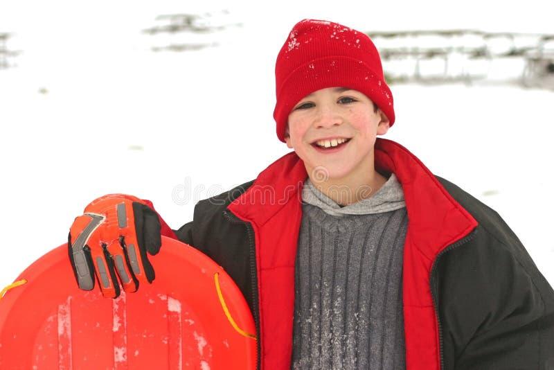 Jongen Sledding royalty-vrije stock afbeelding
