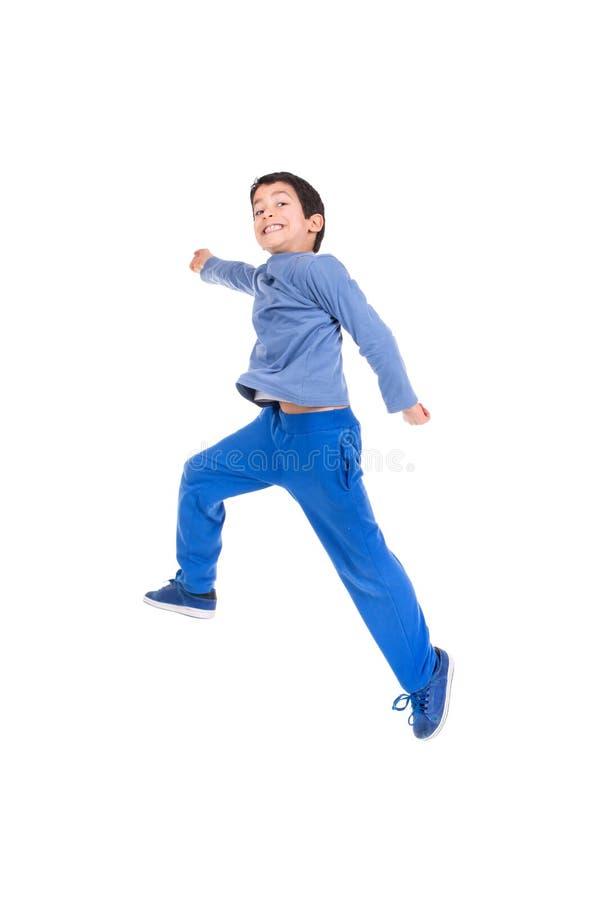Jongen springen geïsoleerd in wit royalty-vrije stock afbeeldingen