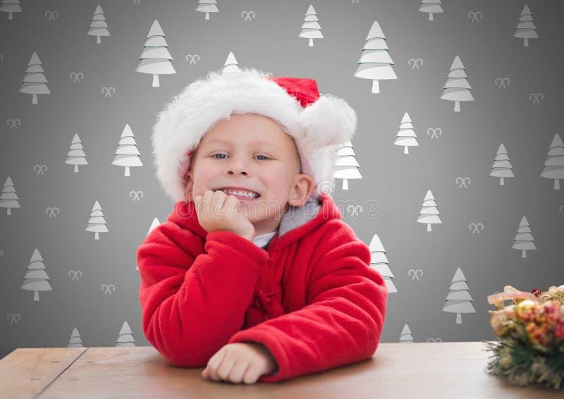 Jongen tegen grijze achtergrond met de hoed van de Kerstmiskerstman en Kerstboompatroon stock illustratie