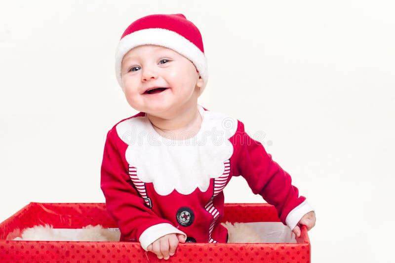 Jongen van de baby kleedde zich als Kerstman stock foto