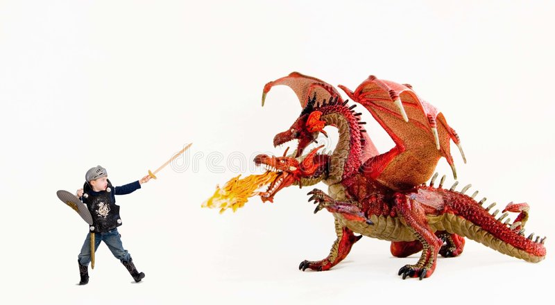 Jongen versus draak stock afbeeldingen