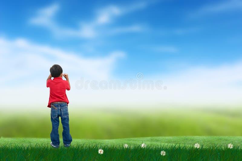 Jongens drowing hemel stock afbeeldingen