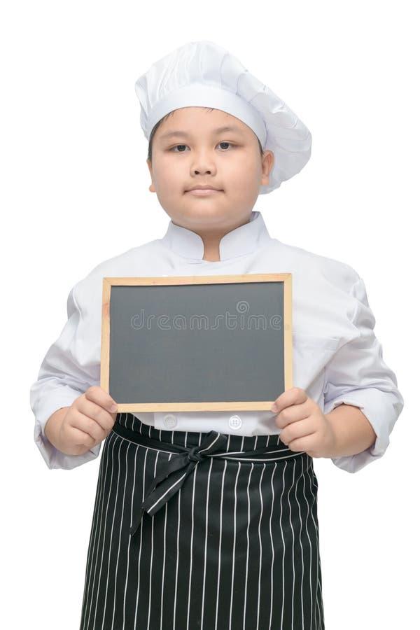 Jongenschef-kok in het eenvormige bord van de kokholding royalty-vrije stock foto's
