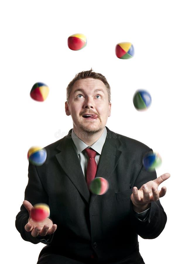 jonglerie d'homme d'affaires image libre de droits