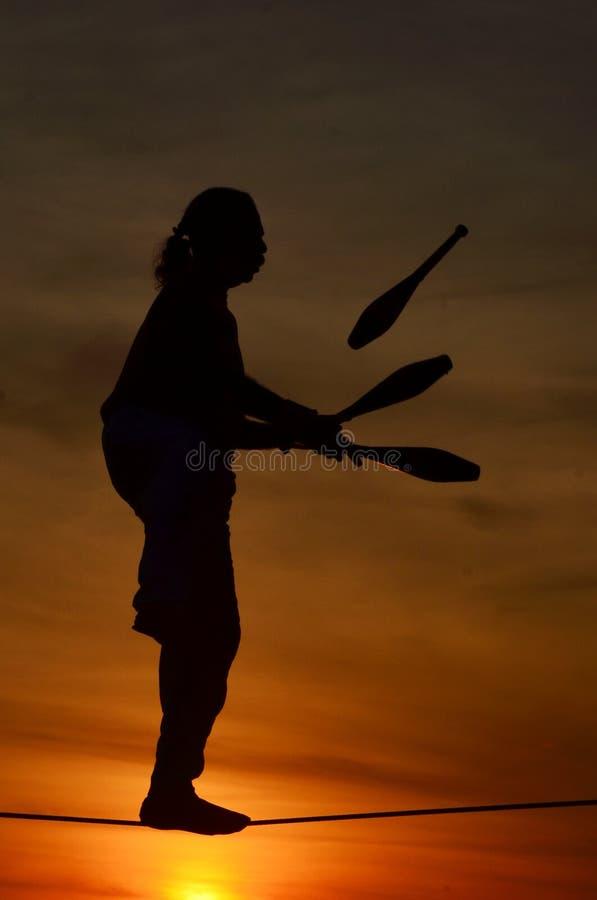 Jongleur au coucher du soleil de Mallory Square, Key West, la Floride photographie stock