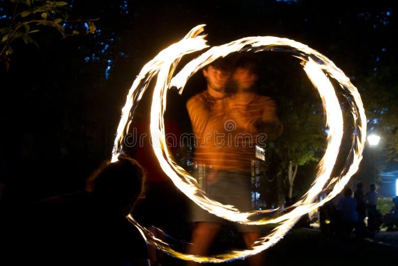 Jongleurs d'incendie photographie stock libre de droits