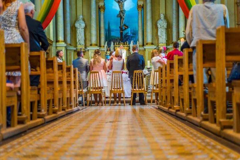Joniskis Sant Church of the Assumption of the Virgin Mary. Lithuania. The interior. Ecclesiastical ceremony.  stock photography
