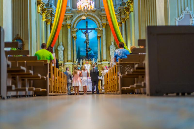 Joniskis Sant Church of the Assumption of the Virgin Mary. Lithuania. The interior. Ecclesiastical ceremony.  stock image