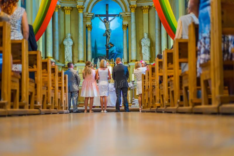 Joniskis Sant Church of the Assumption of the Virgin Mary. Lithuania. The interior. Ecclesiastical ceremony.  royalty free stock images