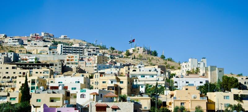 Jordan City view. A View of a typical city in Jordan with a jordanian flag stock photos