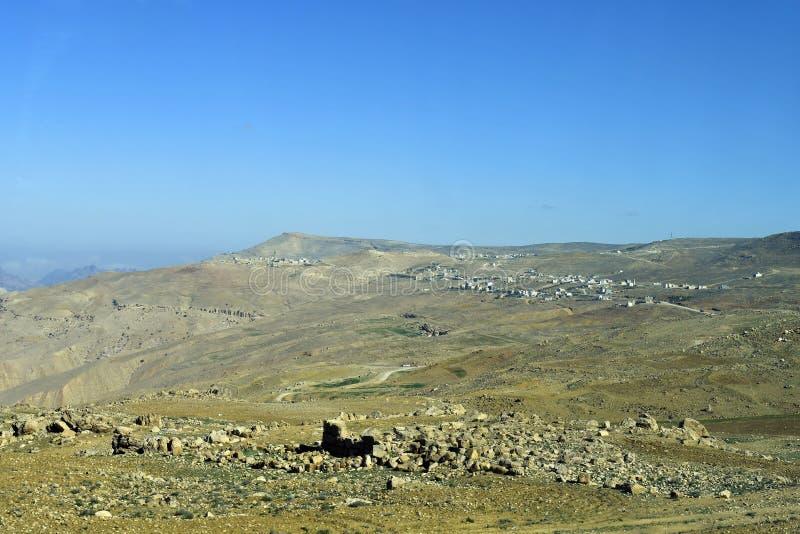 Jordan, settlement in arid landscape. Jordan, tiny settlements on mountain in Tafila district royalty free stock photos