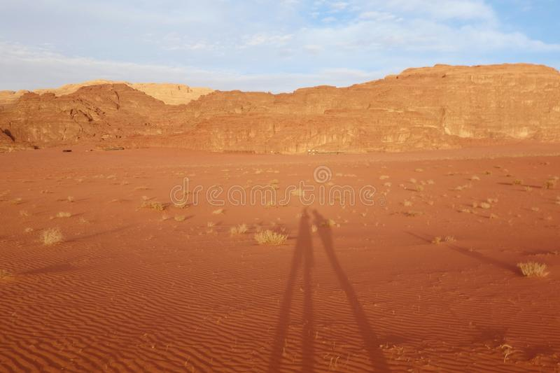 Shadows of two young traveller in Jordanian desert Wadi Rum, Jordan. Wadi Rum has led to its designation as a UNESCO World Heritag stock photos