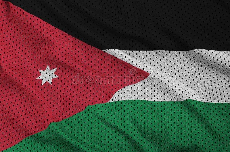 Jordanienflaggan skrivev ut på ett tyg för ingrepp för polyesternylonsportswear fotografering för bildbyråer