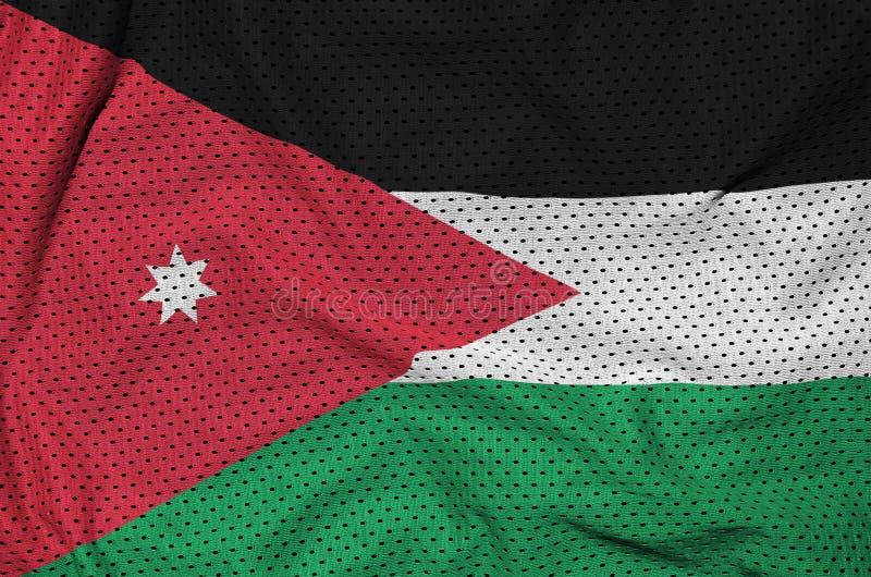 Jordanienflaggan skrivev ut på ett tyg för ingrepp för polyesternylonsportswear arkivbilder