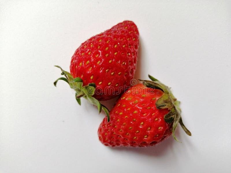 Jordgubbar som isoleras på vitbakgrund fotografering för bildbyråer