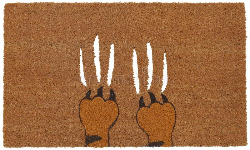 Jordluckrare för Aggeresive beigea färgtiger på mattt för dörr för zute/för Coir utomhus- royaltyfri foto