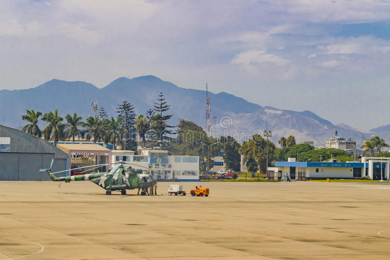 Jorge Chavez Airport, Lima, Peru. LIMA, PERU, APRIL - 2016 - Military helicpoter parked at Jorge Chavez airport in Lima city, Peru royalty free stock photo
