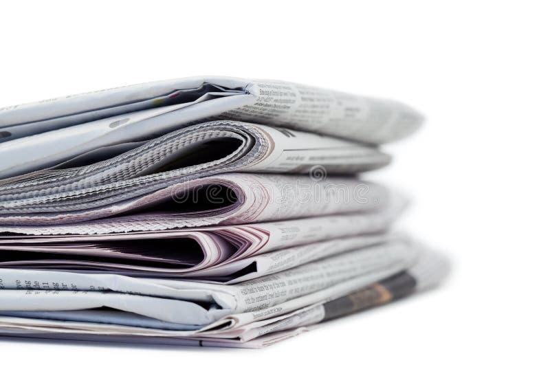 Jornais em um fundo branco fotos de stock