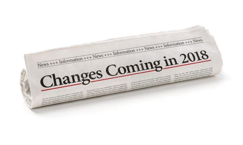 Jornal com as mudanças do título que vêm em 2018 imagem de stock
